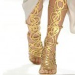 Fotos de sandália gladiadora dourada longa