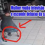 Câmera flagra mulher roubando uma tv de plasma e colocando entre as pernas
