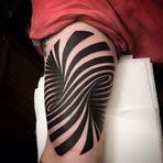 Ilusão de ótica: Tatuador usa geometria para criar buraco no braço de cliente