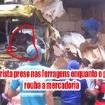 Mesmo com o corpo do motorista preso nas ferragens após acidente pessoas roubam toda mercadoria