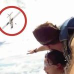 Vídeos - Casal passa perto da morte durante salto de paraquedas