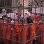 Radicais do Estado Islâmico colocam crianças em gaiola em protesto contra ataques sírios