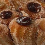 Churro é um alimento de origem ibérica, muito popular nos países latino-americanos.